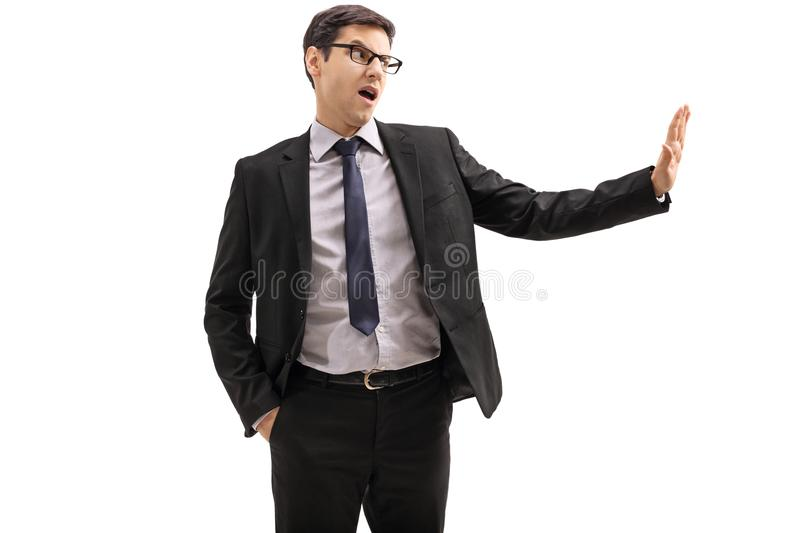 Businessman making a refuse gesture stock photo