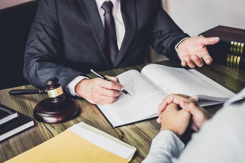 Businessman and Male lawyer or judge consult having team meeting. With client, Law and Legal services concept stock image