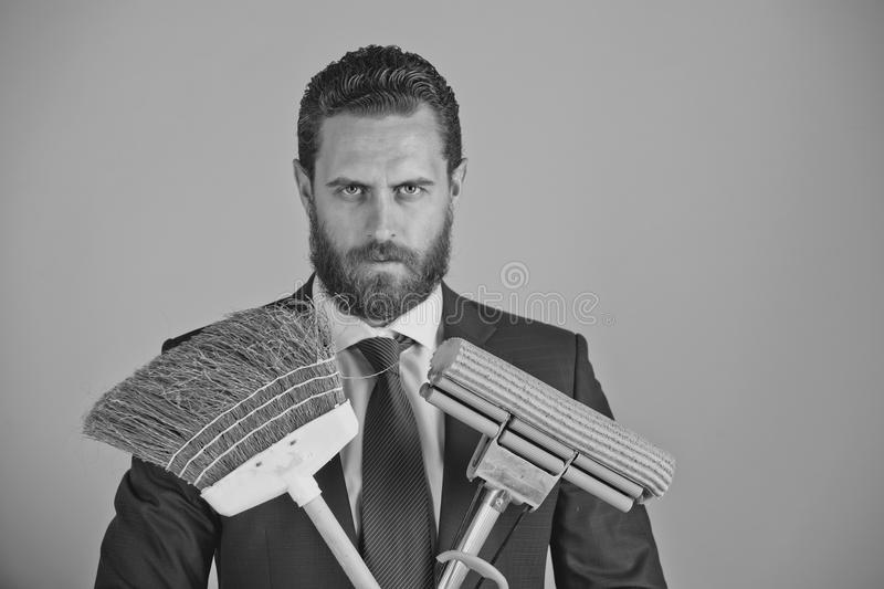 Businessman or man with serious face, broom in business outfit stock image