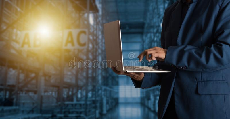 Businessman manager using laptop check orders online goods royalty free stock photography
