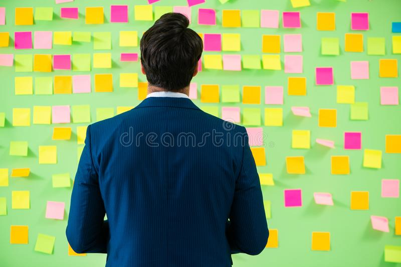 The businessman with many business priorities. Businessman with many business priorities royalty free stock photography