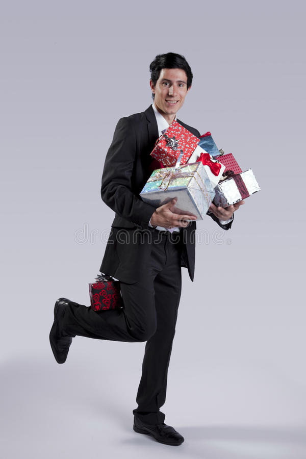 Businessman with many gift packages stock image