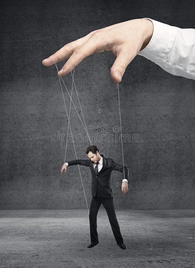 Businessman marionette. On ropes controlled hand stock images