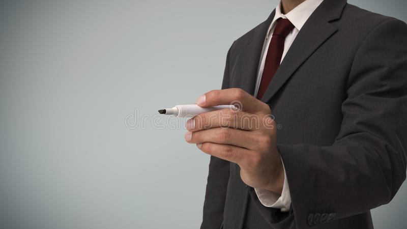 Businessman with a marker stock images