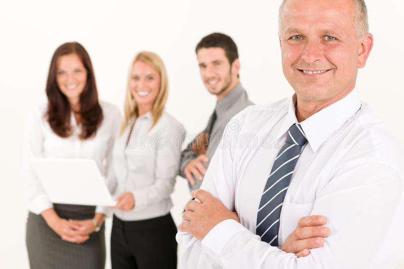 Businessman mature with colleagues stand in back