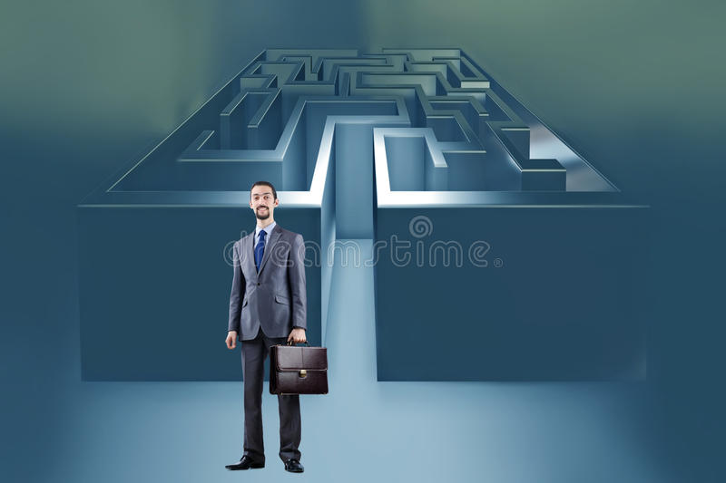 The businessman with maze in difficult situations concept. Businessman with maze in difficult situations concept royalty free stock image