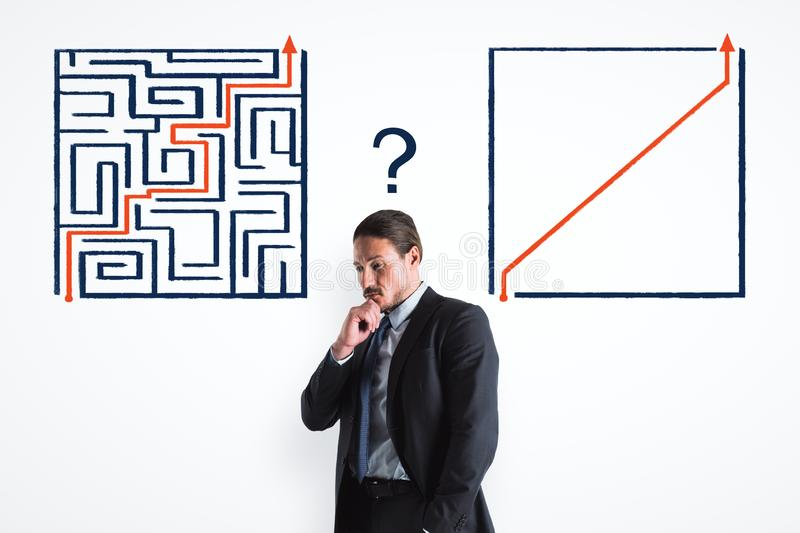 Businessman with maze. Portrait of attractive young european businessman with maze sketch on white background. Challenge, plan and goal concept royalty free stock photography