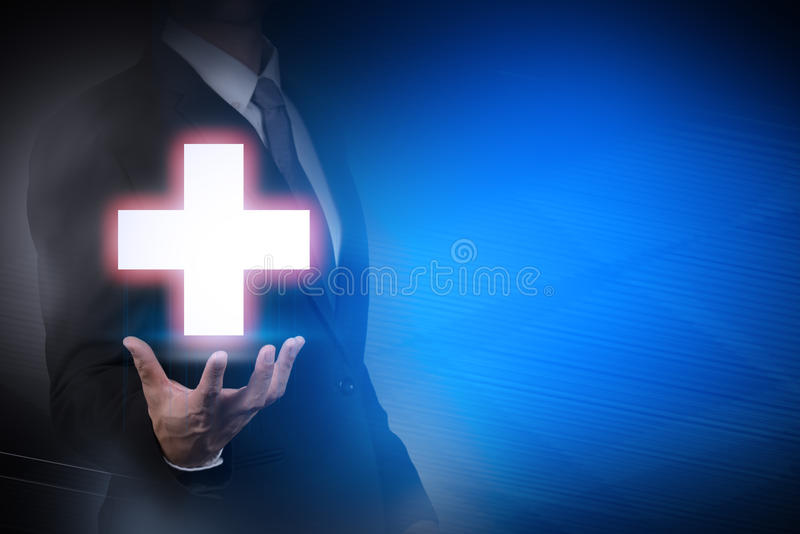 Businessman with medical sign on abstract background. Health,insurance stock photo
