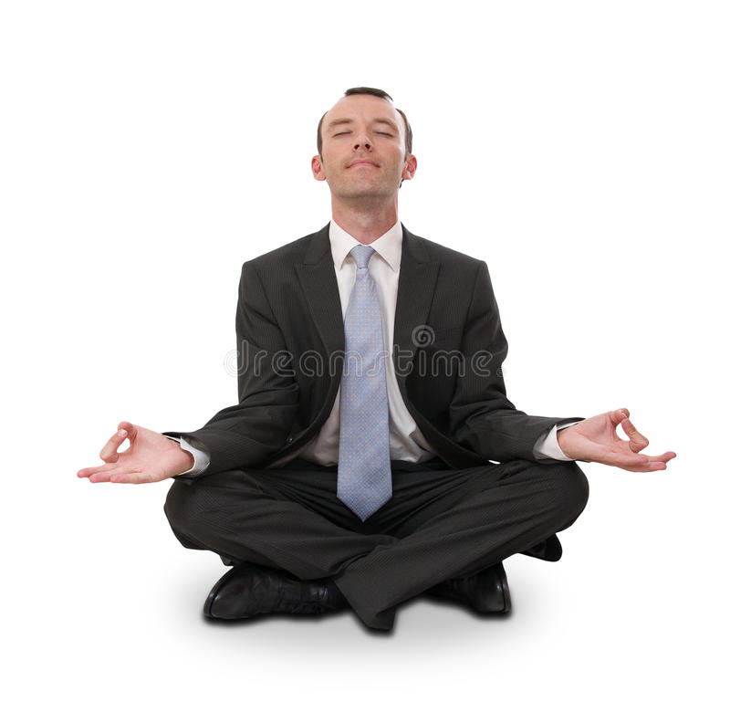 Businessman meditating. Relaxed businessman meditating isolated on white stock photo