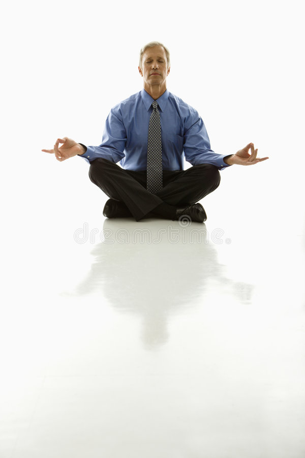 Businessman meditating. stock photography