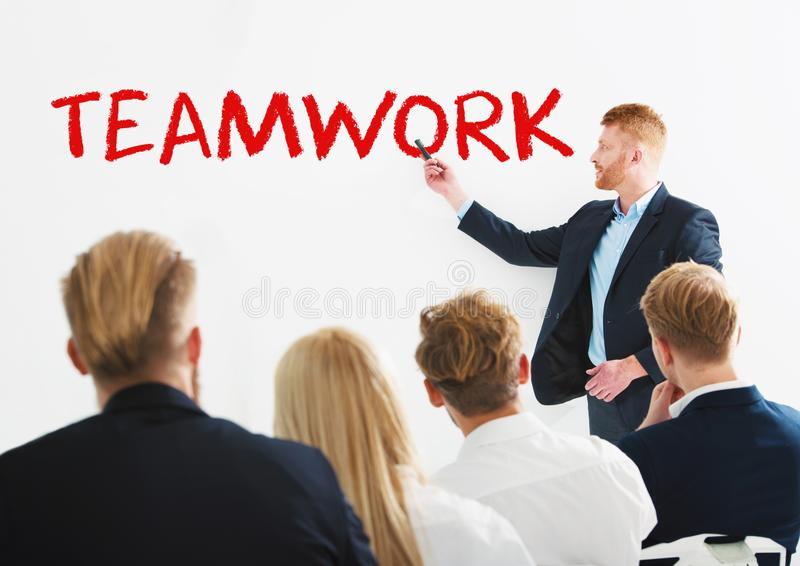 Businessman in office explain something about teamwork at a training meeting royalty free stock photography