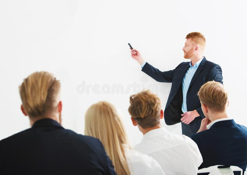 Businessman in office explain something at a training meeting stock image