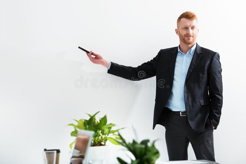 Businessman in office explain something at a training meeting royalty free stock image