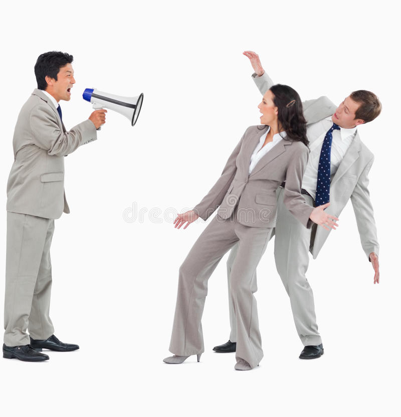 Download Businessman With Megaphone Shouting At Colleagues Stock Photo - Image: 22861654