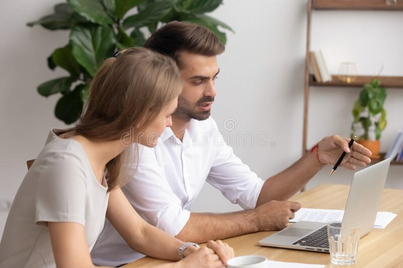 Businessman, mentor and trainee working on project together, using laptop stock photo