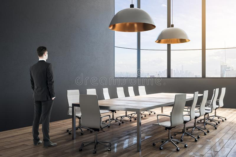 Businessman in minimalistic conference room royalty free stock images