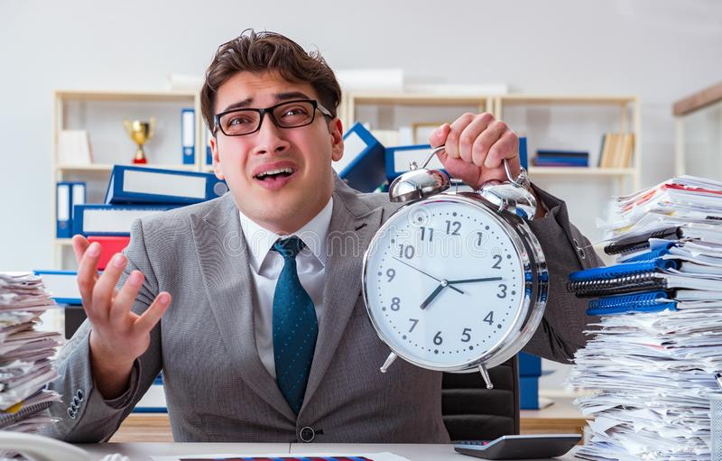Businessman missing deadlines due to excessive work. The businessman missing deadlines due to excessive work royalty free stock photo