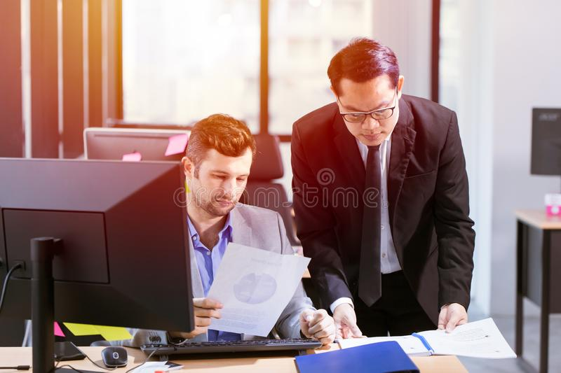 Businessman mix race help or working together in office stock photo
