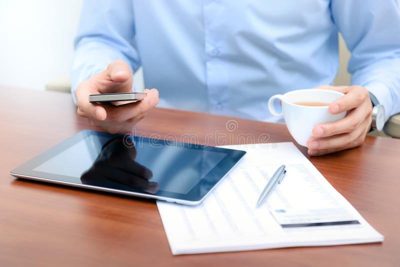 Businessman with mobile phone communication. Businessman using new technologies for success workflow
