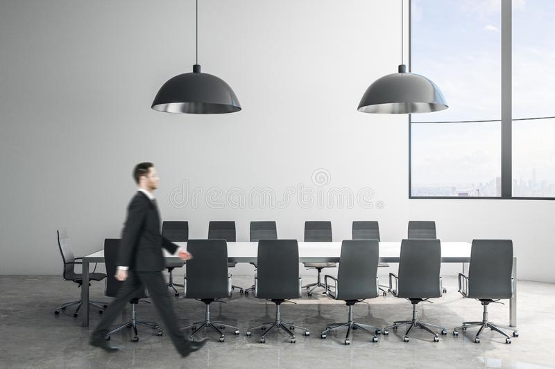 Businessman in modern conference room royalty free stock images