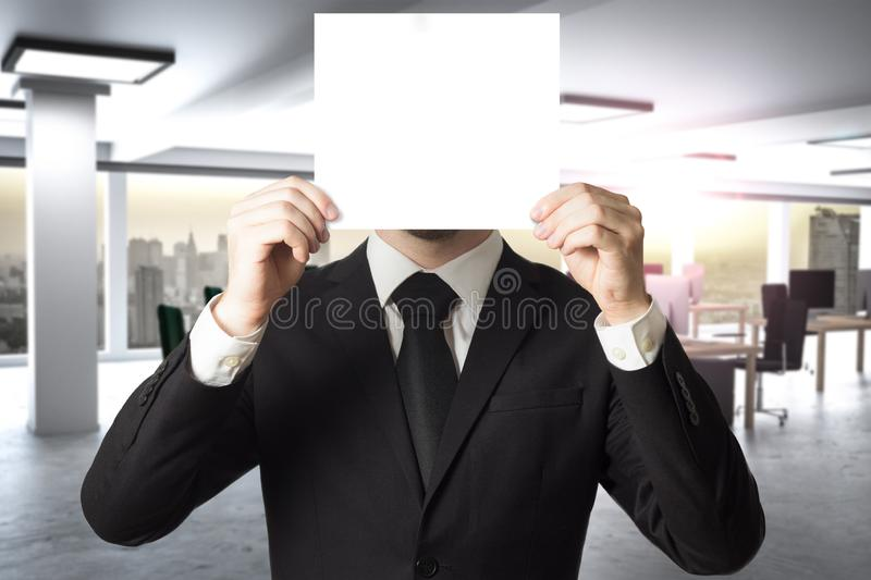 Businessman in modern office hides face behind sign 3D Illustration royalty free stock photography