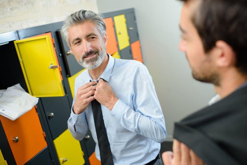 Businessman in modern wood interior locker royalty free stock images