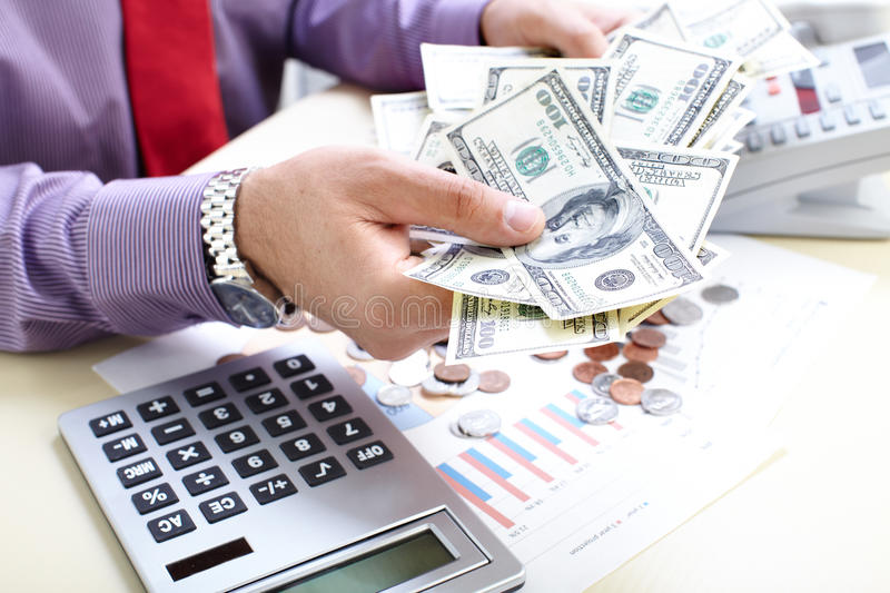 Businessman and money. Businessman with cash, money, bills, coins royalty free stock photo