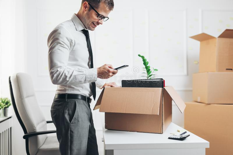 Businessman moving into a new office stock photo