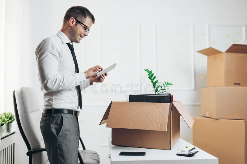 Businessman moving into a new office stock images