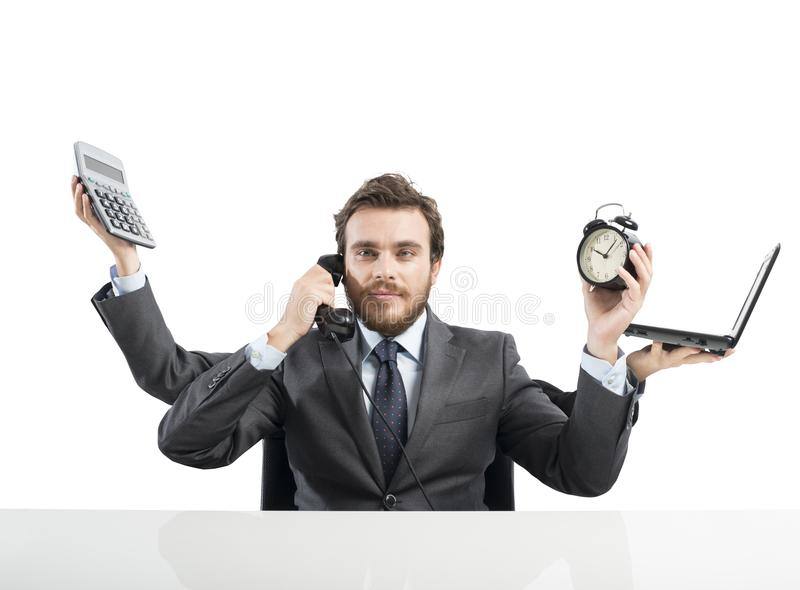 Businessman multitasking stock photography