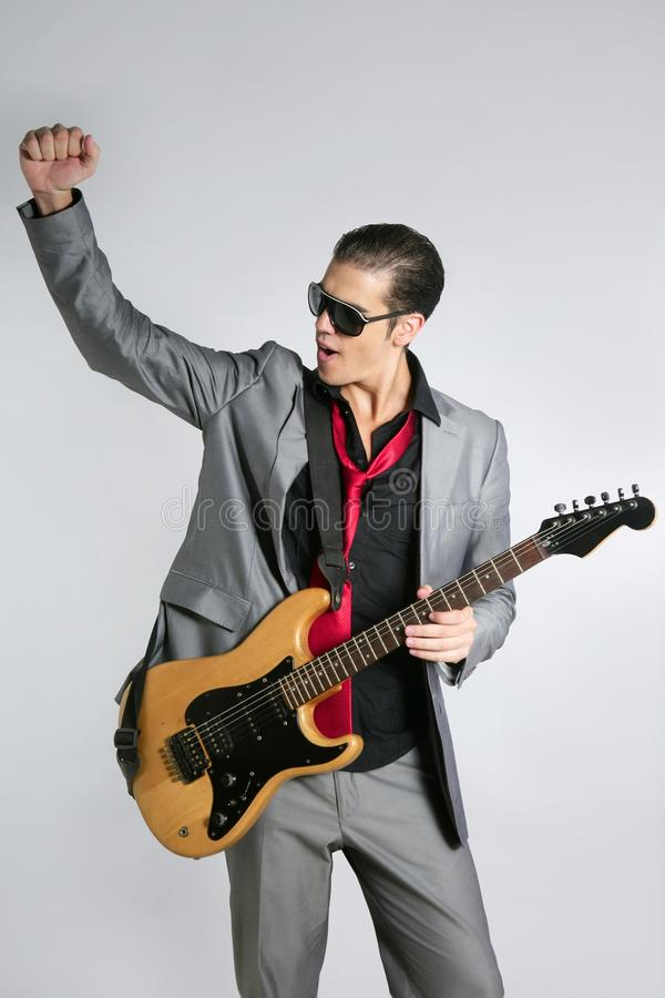 Download Businessman Musician Playing Instrument With Suit Stock Photo - Image: 10903996