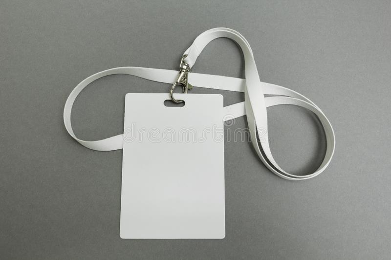 Businessman name card on a lanyard. Identification tag isolated on gray background. Blank ID card stock image