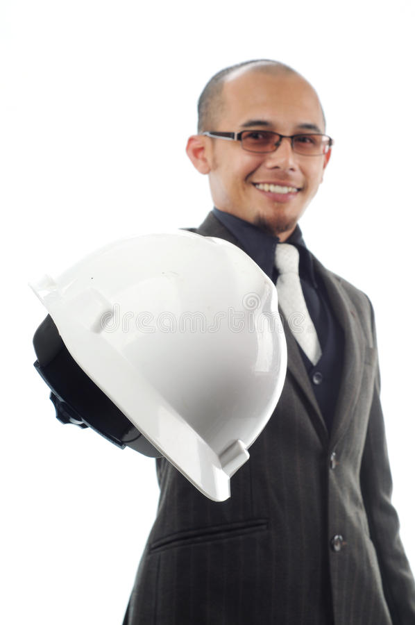 Businessman nand over the safety helmet. Isolated white background stock photos