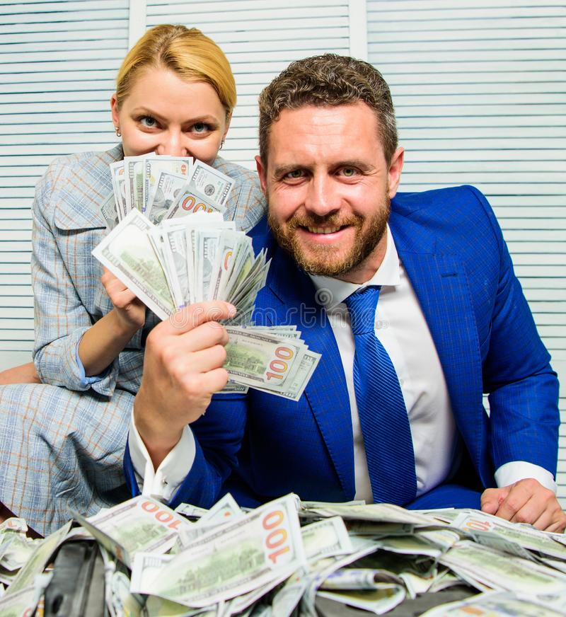 Businessman near cash dollars profit. Huge profit concept. Counting money profit. Financial success. Man businessman and stock image