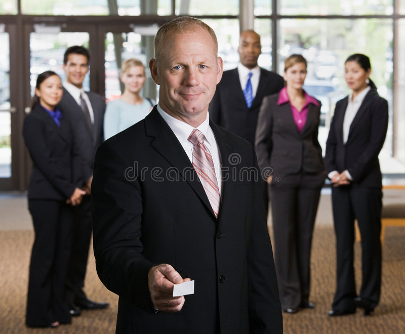 Businessman offering business card stock image