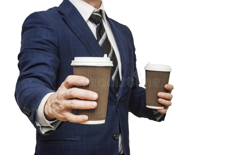 Businessman offering coffee in paper cup. Businessman offers a cup of coffee. Businessman holding two disposable coffee cup royalty free stock images