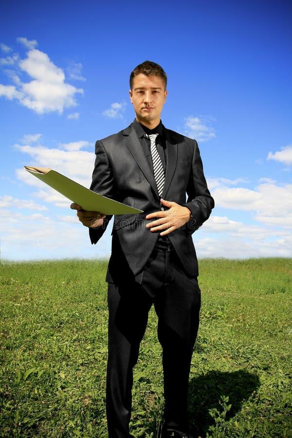 Businessman Offering A Folder Stock Images