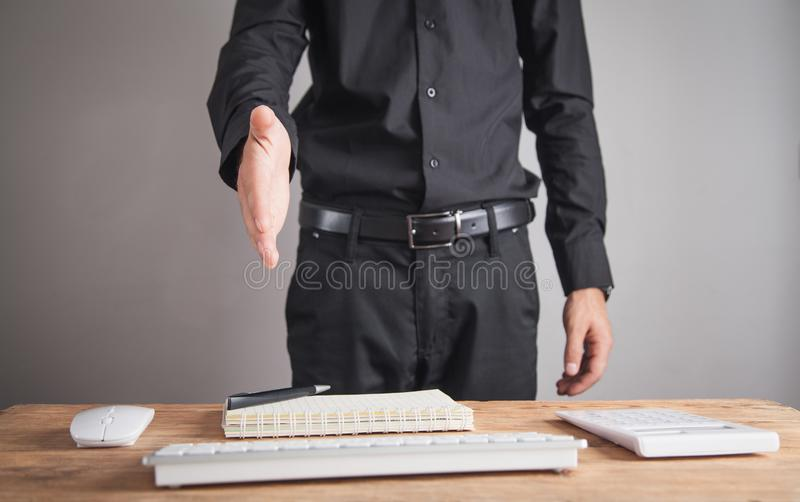 Businessman offering hand for handshake. Deal concept royalty free stock photos