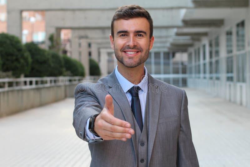 Businessman offering a handshake stock photos