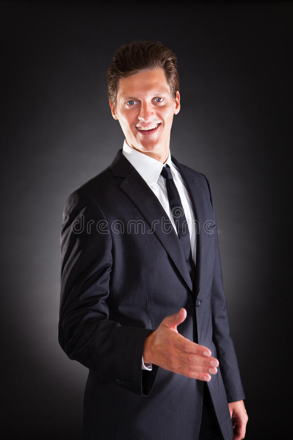 Businessman Offering Handshake stock photography