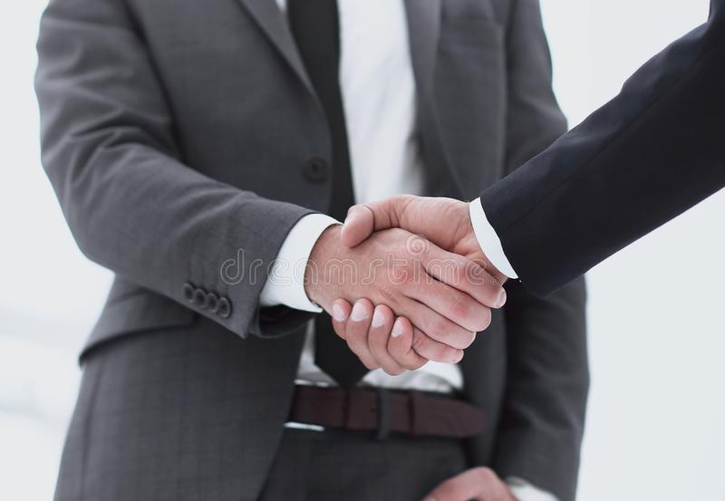 Bussines hand shaking will show succesful cooperation. Businessman Offering Handshake in meeting room. Success Concept royalty free stock photos