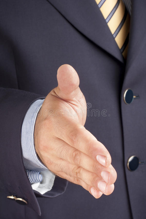 Businessman Offering Handshaking Hand Deal royalty free stock photo