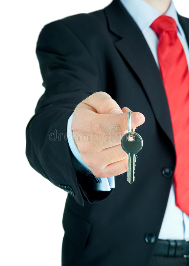 Businessman offering key to Your dream . stock image