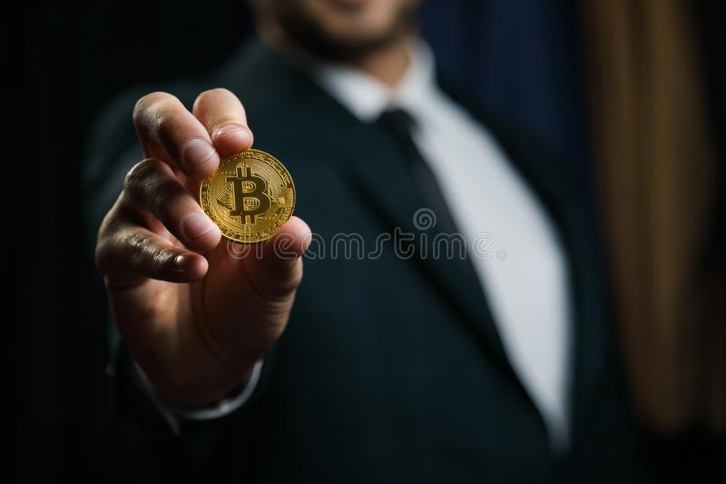 Businessman offers bitcoin - bit coin BTC the new virtual money stock images