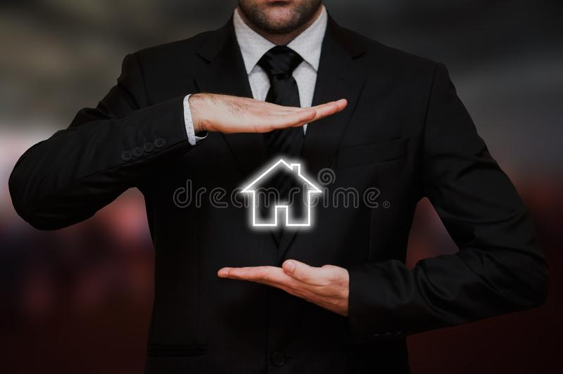Businessman offers a new house concept royalty free stock images