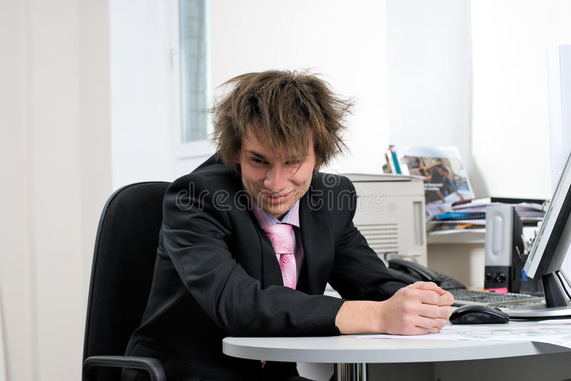 Businessman in office. Young businessman on office workplace with computer royalty free stock images