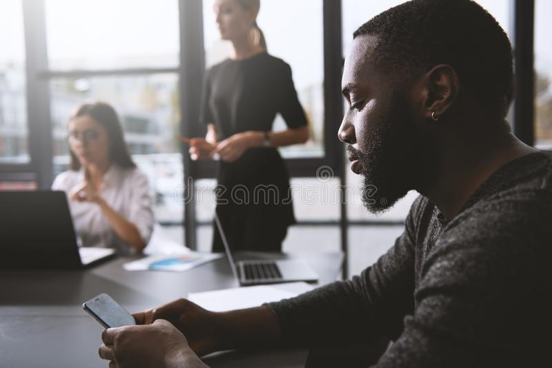 Businessman in office connected on internet network. concept of startup company. Businessman in office connected on internet network with a smartphone. concept stock image
