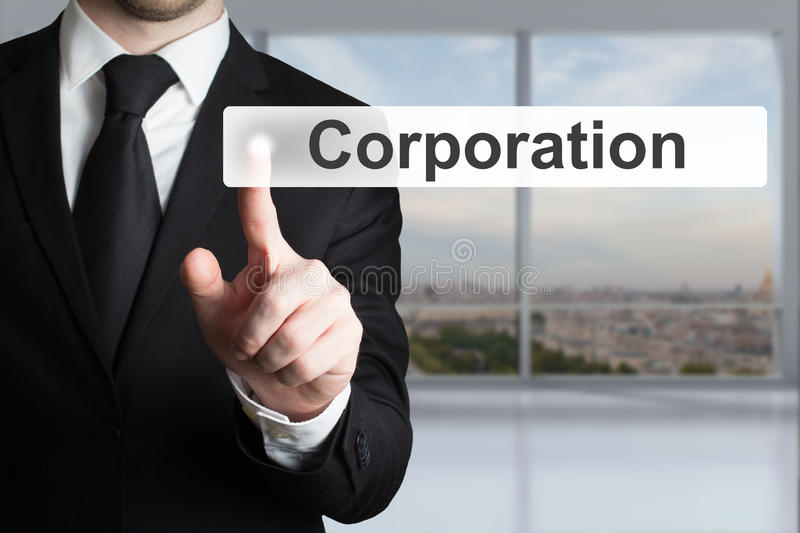 Businessman in office pushing flat touchscreen button corporati. Businessman in black suit pushing flat touchscreen button corporation stock image