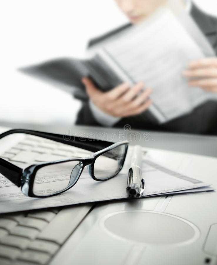 Businessman at office reading a contract stock photo