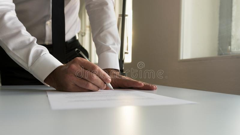 Download Businessman In Office Signing Contract, Document Or Legal Papers Stock Image - Image of light, legal: 104975281